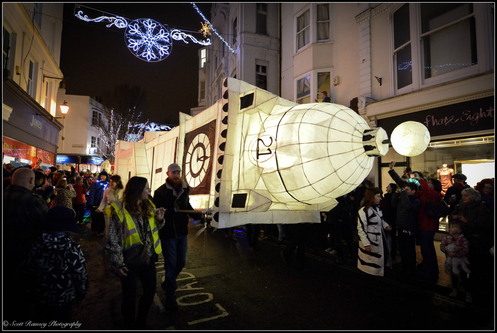 A paper lantern in the shape of Brighton's Jubilee Clock Tower is carried through the streets in Brighton during the Burning The Clocks event.