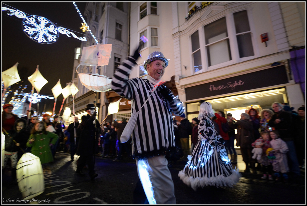 Paper lanterns are carried through the streets of Brighton during the Burning The Clocks community event.