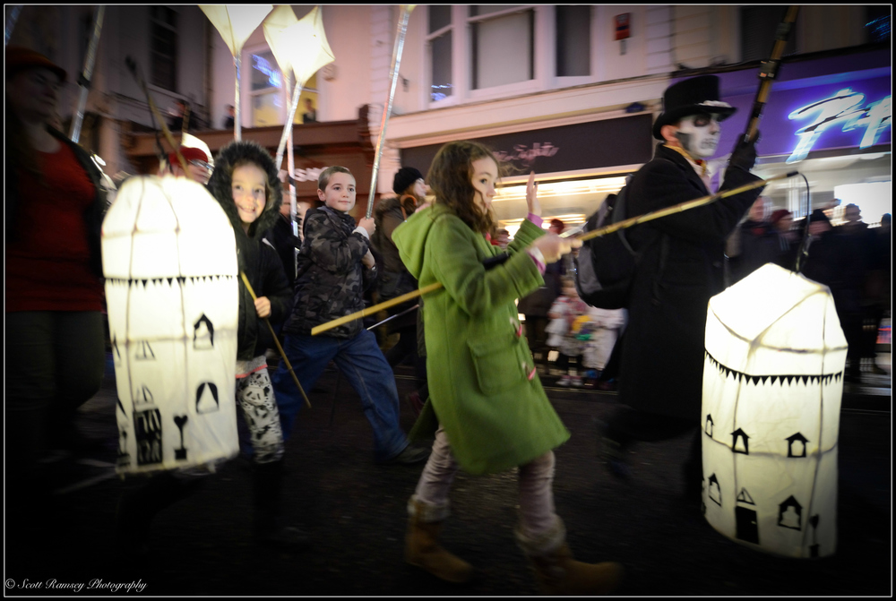 The Burning The Clocks lantern parade makes its way through the dark streets of Brighton.
