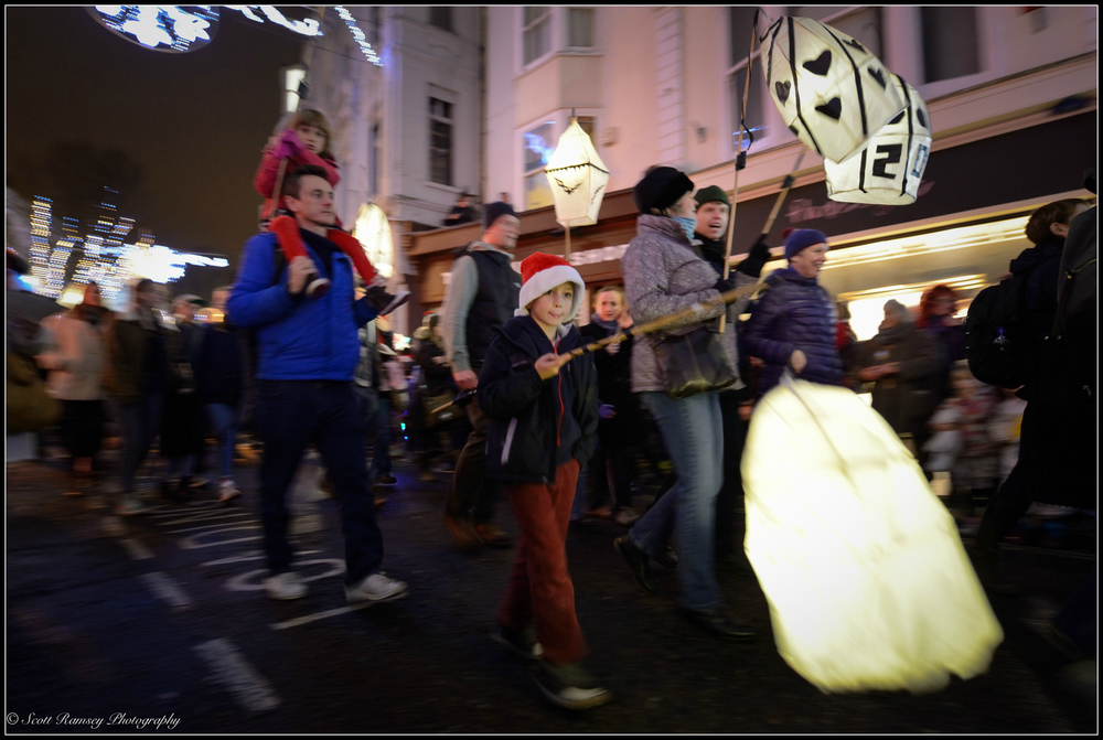 Paper lanterns are carried through the streets of Brighton during the lantern parade at the Burning The Clocks event.