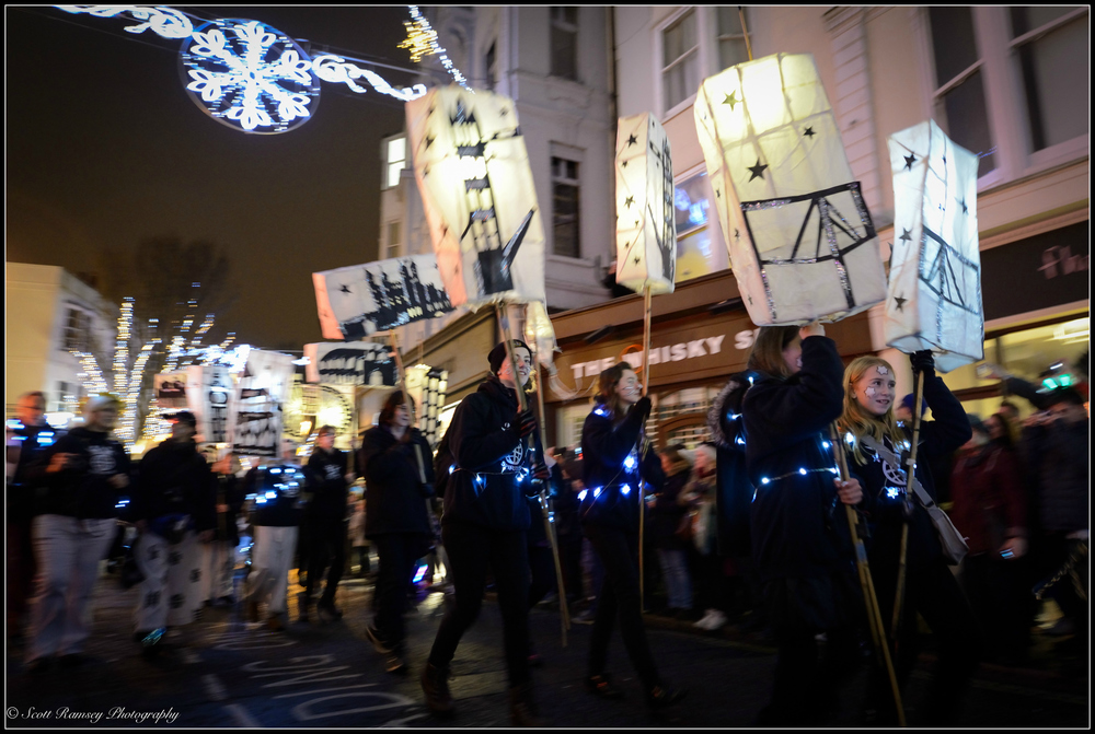 Local community groups take part in the lantern parade during the Burning The Clocks event in Brighton.