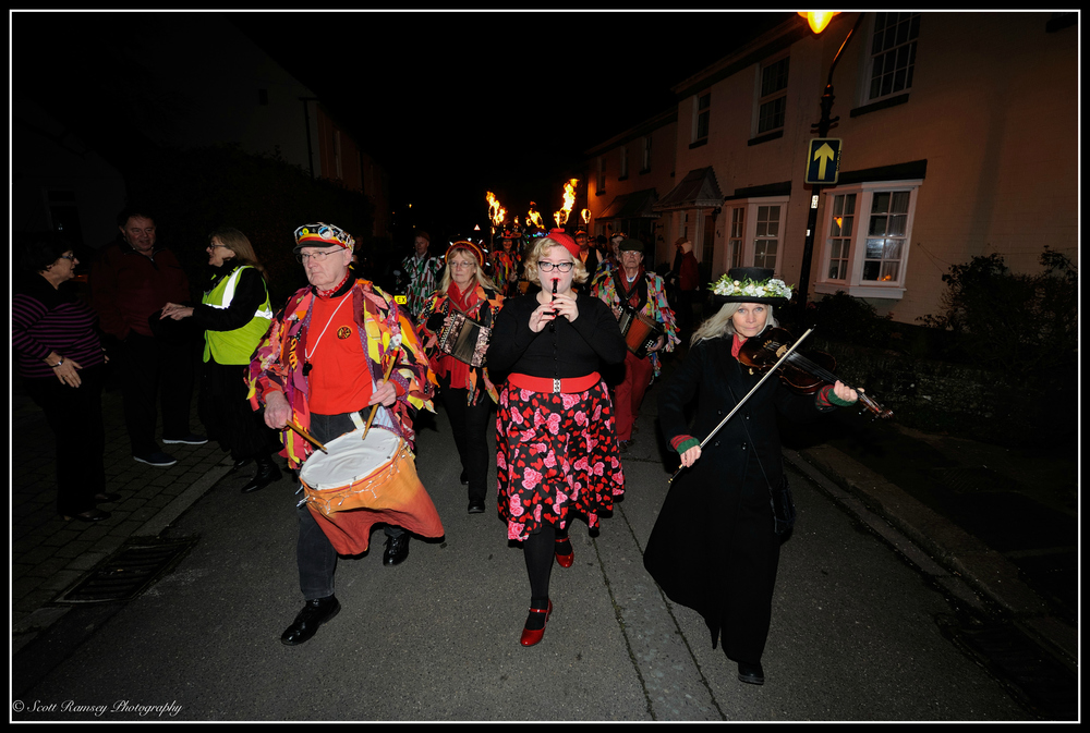 Musicians lead the procession along Tarring High Street during the Wassail.