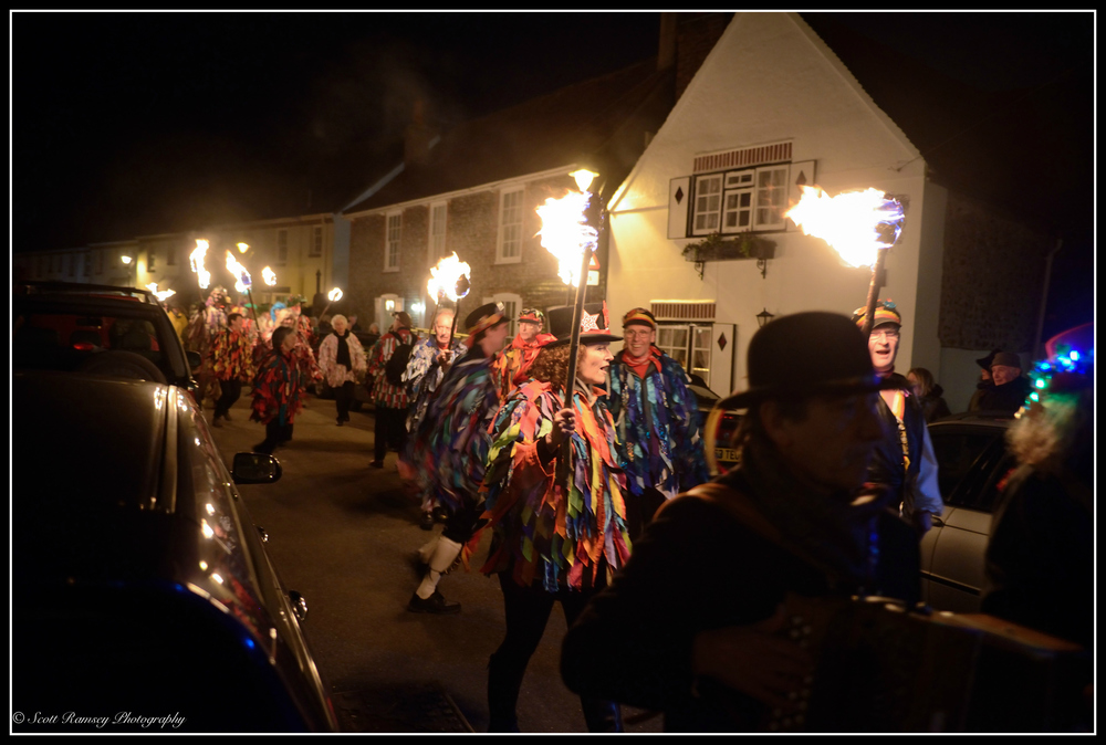 Members of the Sompting Village Morris dance and chant whilst carrying flaming torches through the streets in Tarring, West Sussex during the annual Wassail.