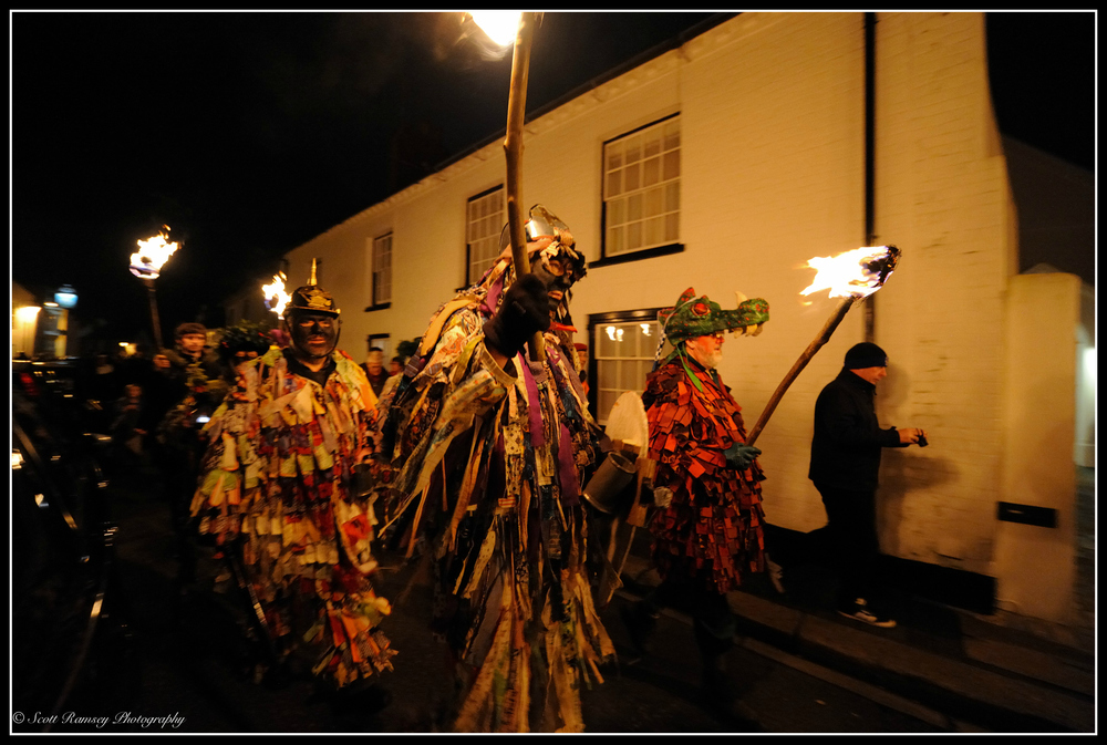 With flaming torches held high, morris men walk through Tarring in West Sussex during the Wassail.
