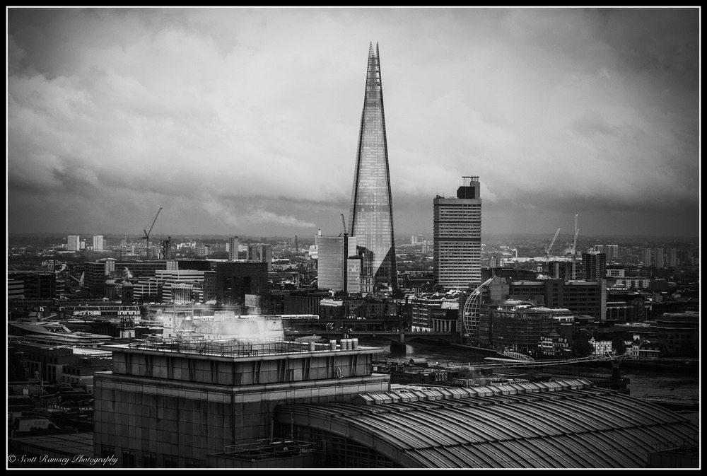 A London Skyline. In the photograph The Shard can be clearly seen towering above the rooftops of the other buildings in London. Photo © Scott Ramsey Photography.