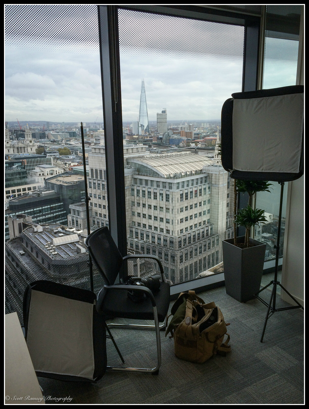 Ready for the corporate photo shot. My photo equipment is set up in front of a large window 17 floors up above London.