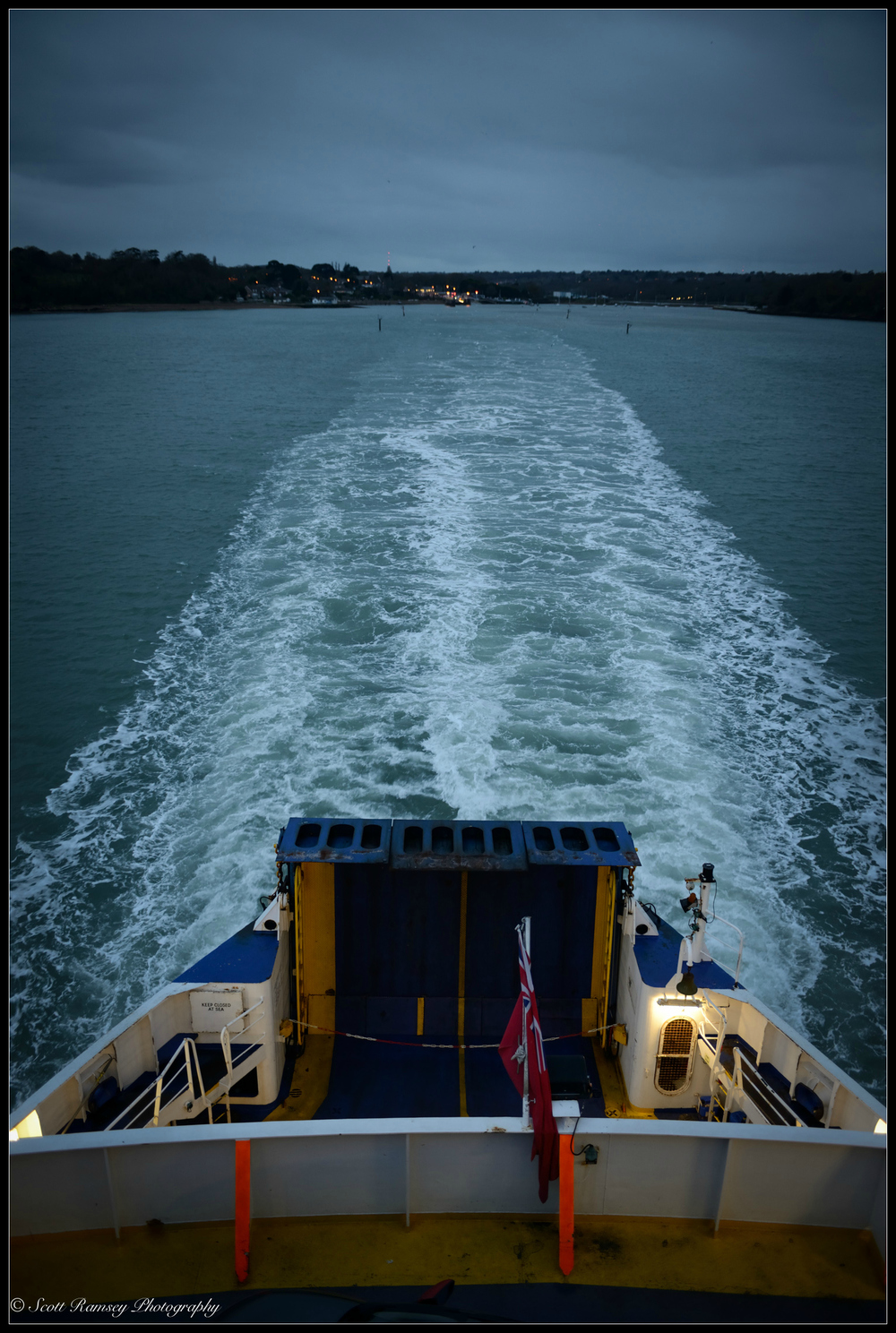 The ferry's propeller stirs up the dark water as the night ferry leaves Fishbourne on the Isle of Wight.