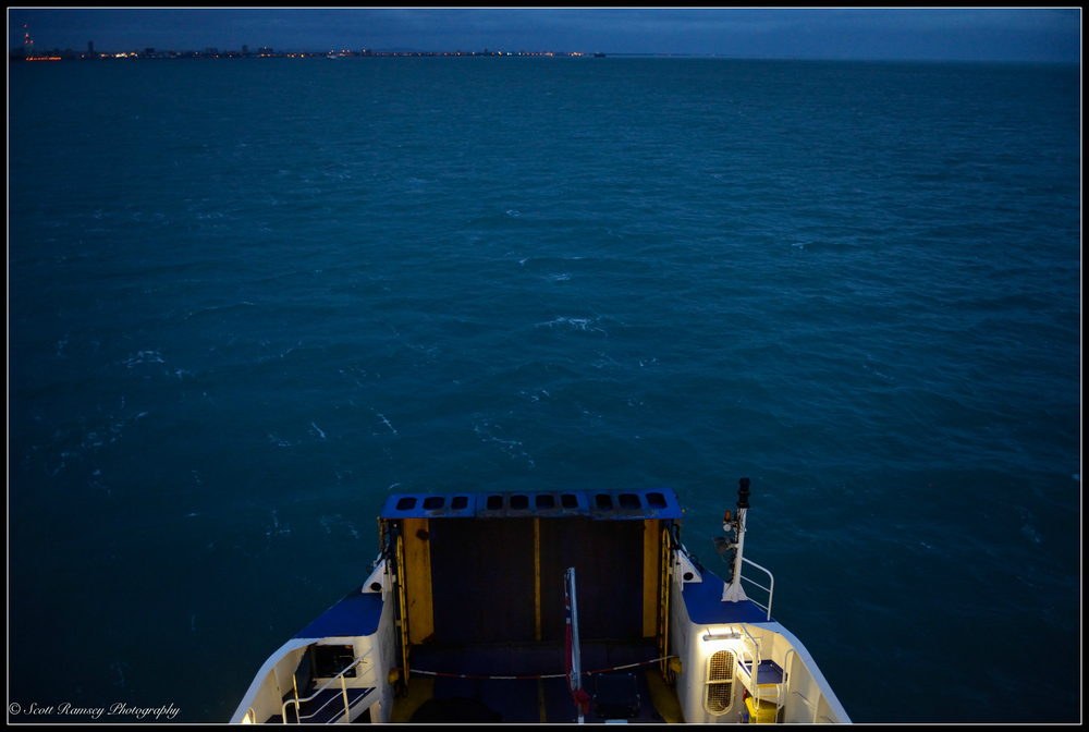 The bow of the ferry pushes it's way through the dark water in the Solent, our destination of Portsmouth and the mainland lies ahead.
