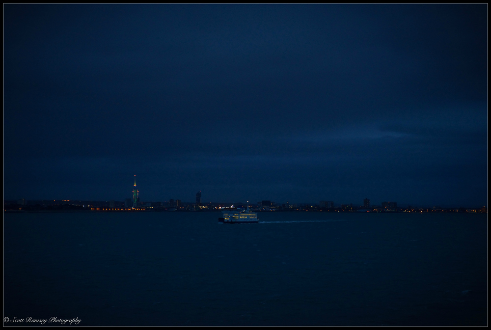 Ships passing in the night. A Wightlink ferry sails past us as we near Portsmouth.