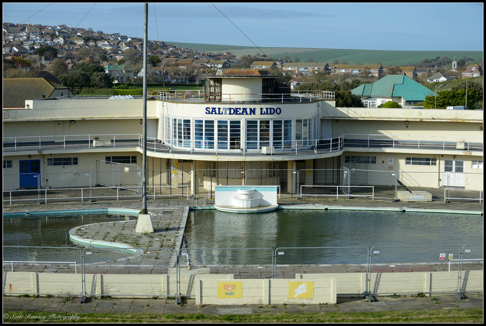 Fenced off and with only local seagulls able to enjoy the open air swimming pool, a derelict Saltdean Lido in East Sussex, UK. © Scott Ramsey Photography
