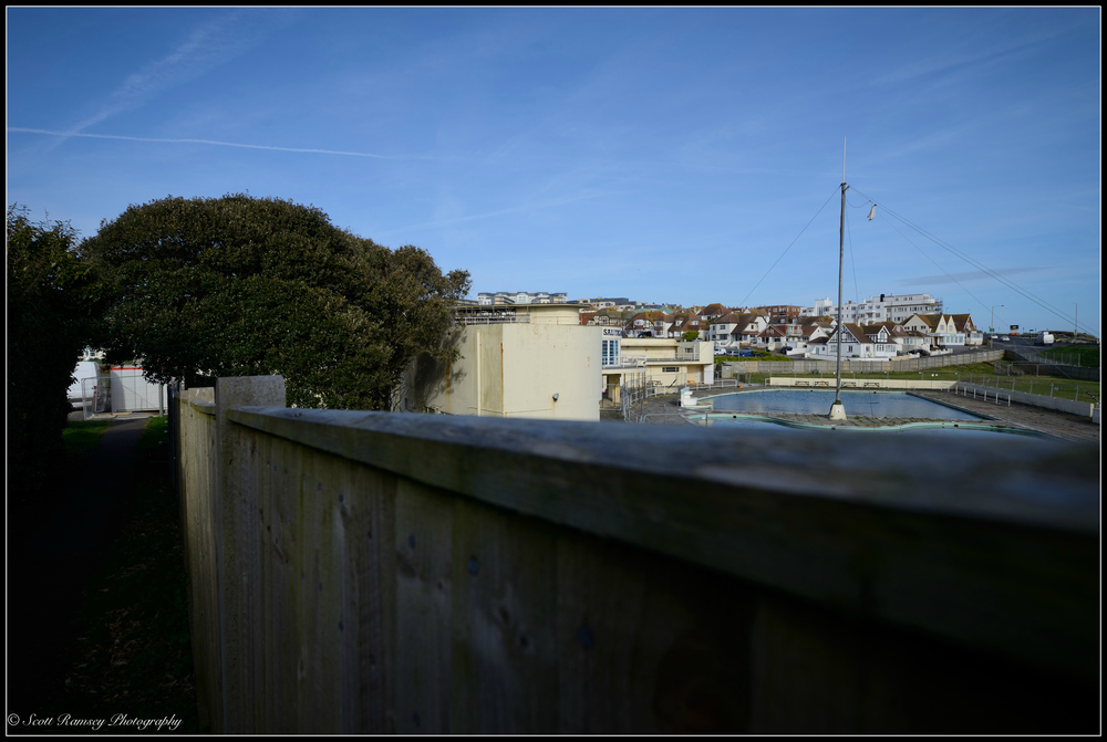 A view over the fence of Saltdean Lido in East Sussex, UK. © Scott Ramsey Photography