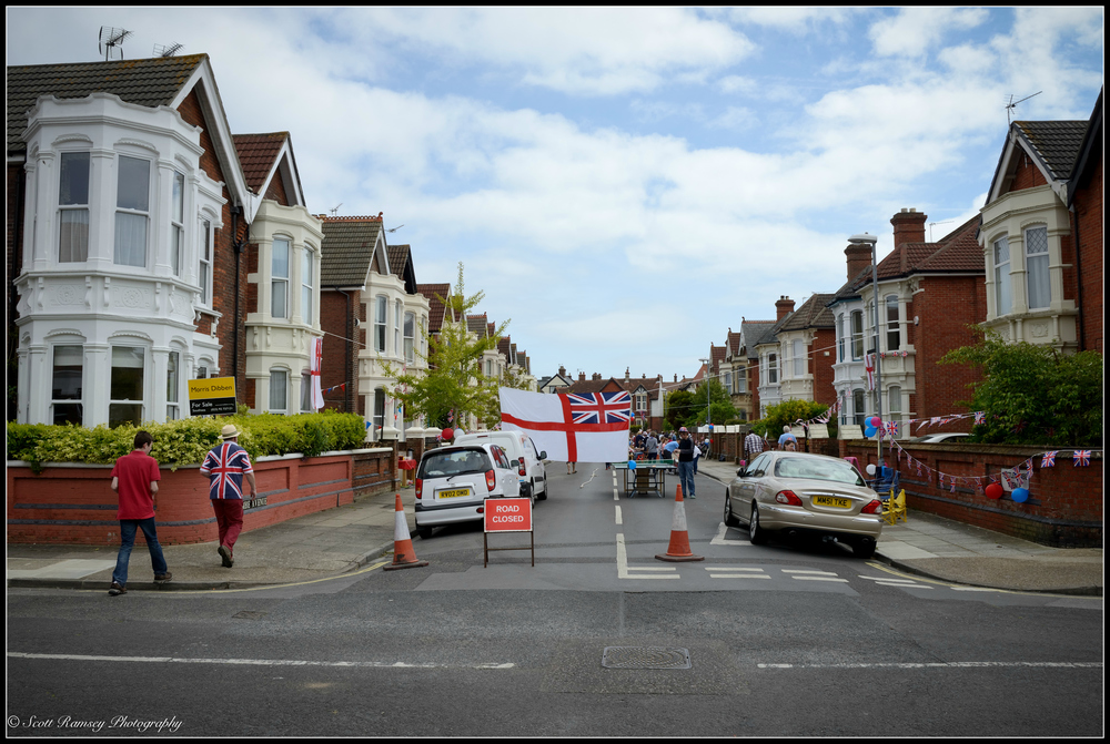 Residents from nearby streets arrive for the VE Day street party in Nettlecombe Avenue, Southsea, Portsmouth., UK. © Scott Ramsey Photography.