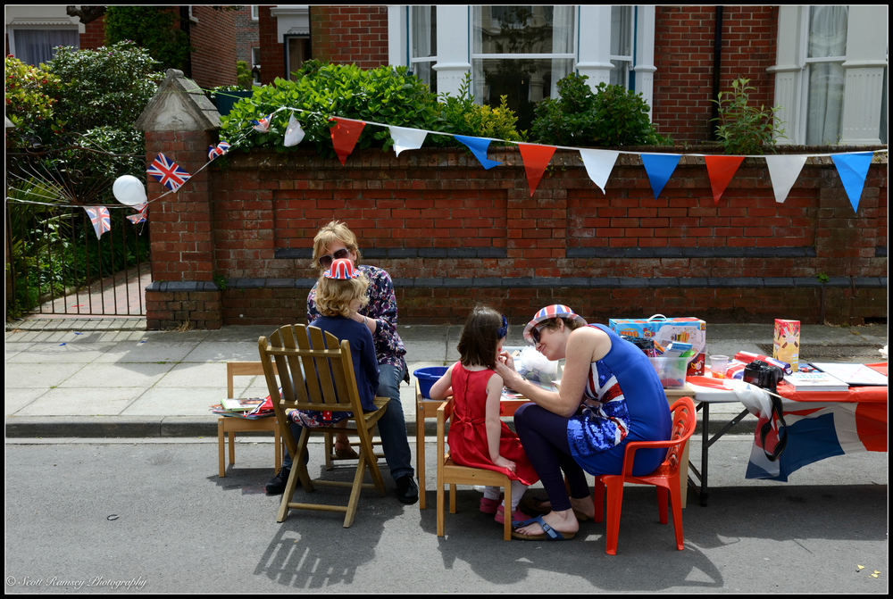 Children have their faces painted in Nettlecombe Avenue in Southsea, Portsmouth during a VE Day 70th anniversary street party. © Scott Ramsey Photography.