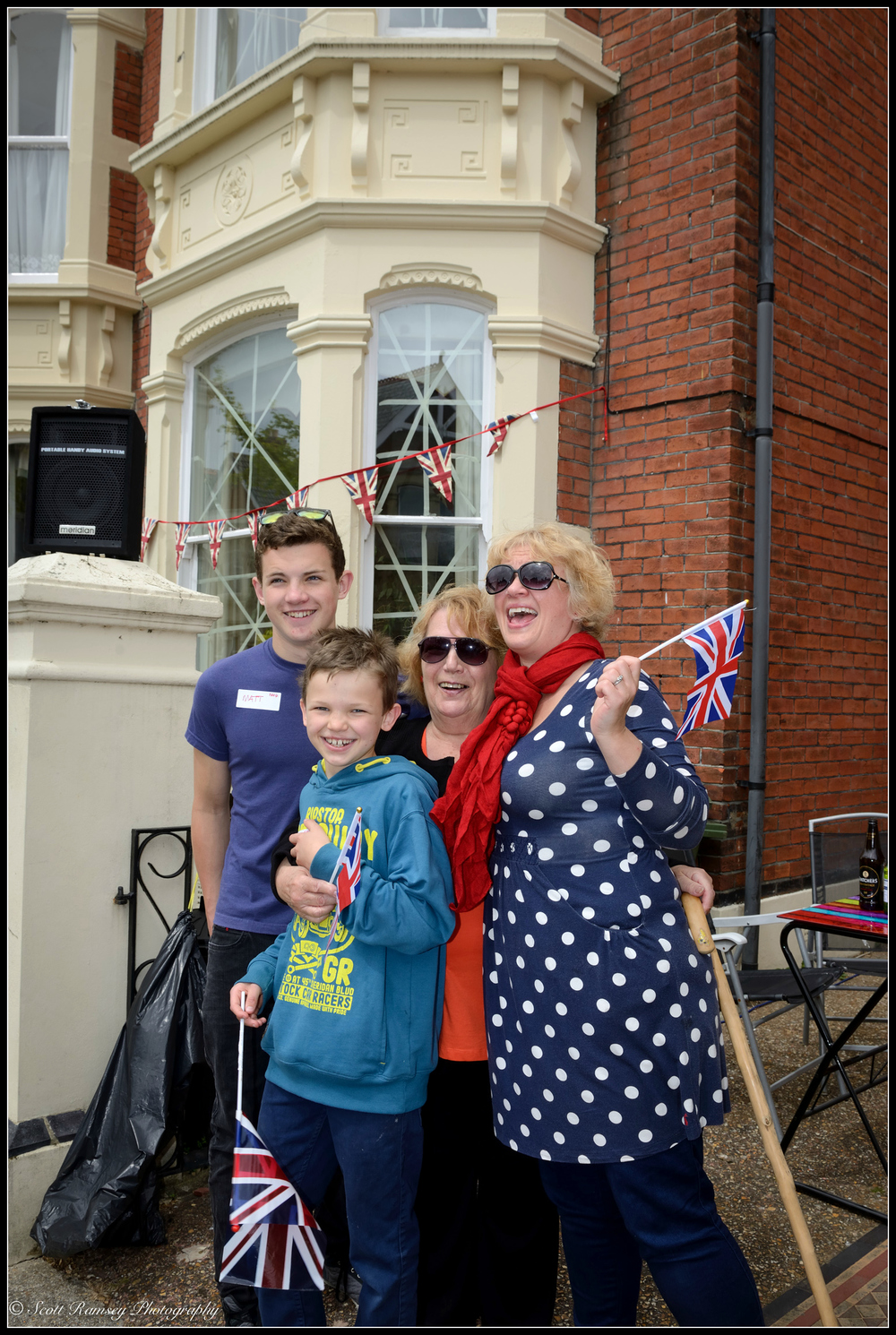 The Nicholson family stand outside their house enjoying the  VE Day street party   in Southsea, Portsmouth.   © Scott Ramsey Photography.