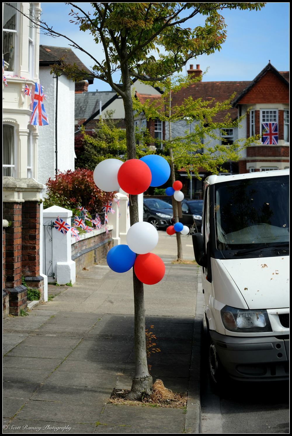 Balloons, flags and bunting in Nettlecombe Avenue, Southsea, Portsmouth during the VE Day 70th Anniversary street party. © Scott Ramsey Photography.