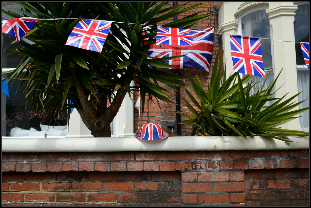 Union jack bunting and a hat outside a house in Nettlecombe Avenue, Southsea, Portsmouth during the VE Day 70th Anniversary street party. © Scott Ramsey Photography.
