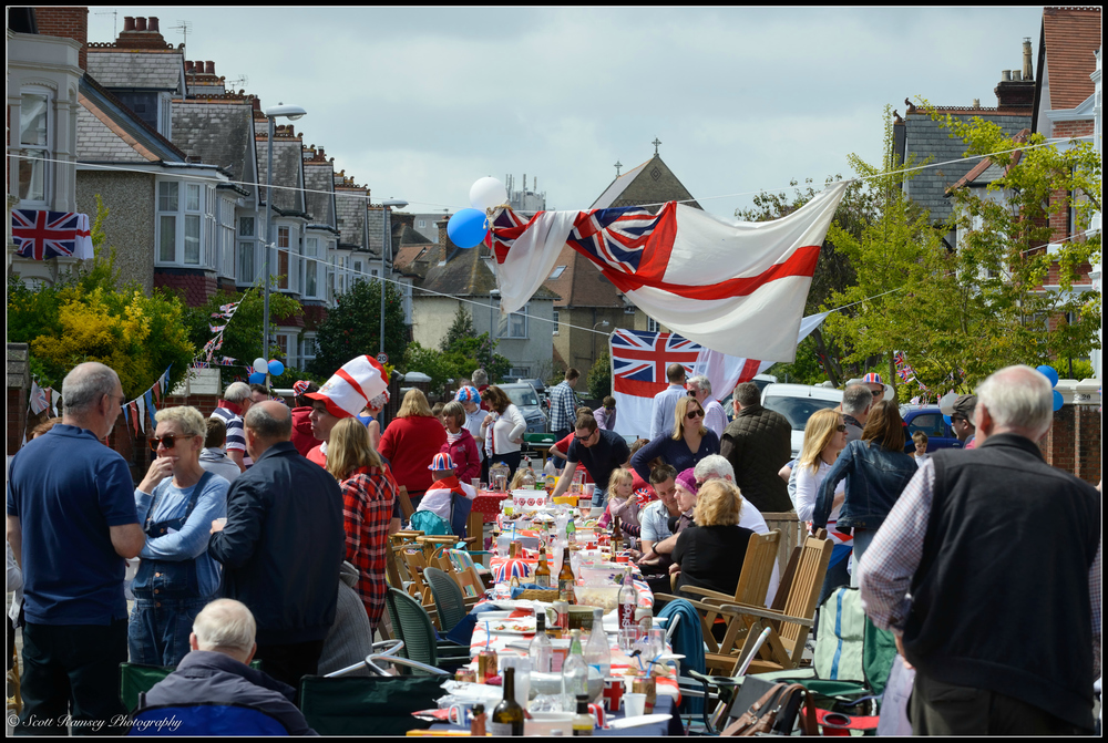 Residents set up tables and chairs and hold a street party outside their homes in Nettlecombe Avenue, Southsea, Portsmouth, UK during the VE Day 70th Anniversary. © Scott Ramsey Photography.