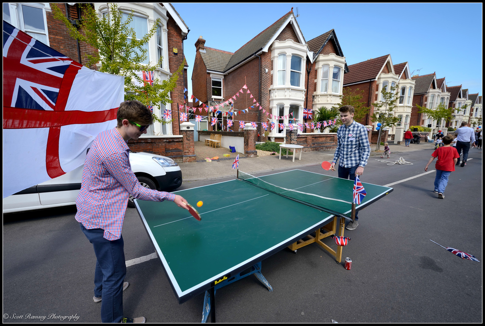 Teenage residents of Nettelcombe Avenue, Southsea make the most of the road being closed for a VE Day street party and enjoy a game of table tennis. © Scott Ramsey Photography.