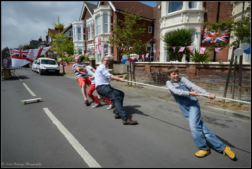 Neighbours pull together in a tug of war match during the VE Day street party in Nettlecombe Avenue, Southsea, Portsmouth, UK. © Scott Ramsey Photography.