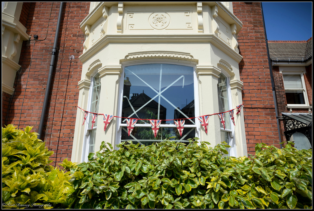 Recreating a scene from the original VE Day celebrations this Nettlecombe Avenue resident has hung bunting up and stuck tape to the windows of their house in Southsea, Portsmouth, UK during the VE Day 70th anniversary street party.© Scott Ramsey Photography.