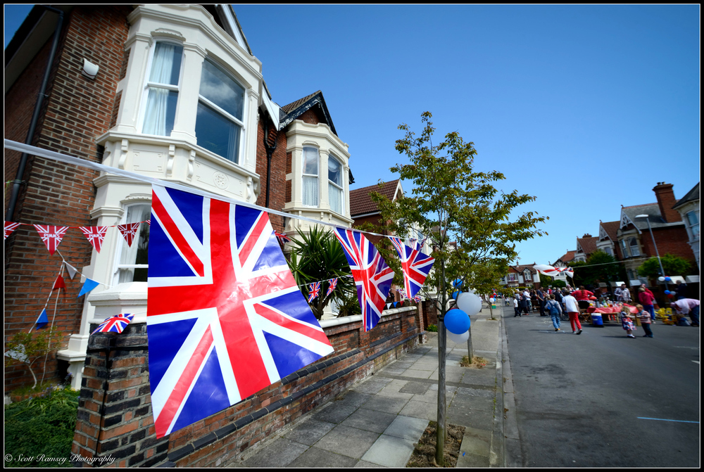 Union jack flags hang outside residents homes in Nettlecombe Avenue, Southsea, Portsmouth, UK during a VE day 70th anniversary street party. © Scott Ramsey Photography.