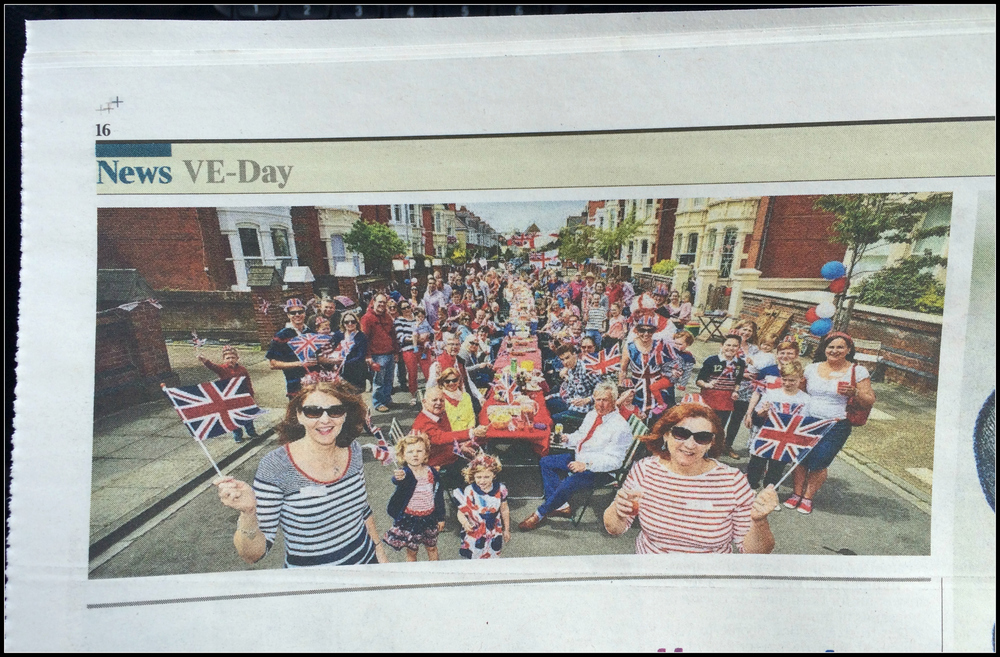 Page 16 of The Times newspaper and my photo of the residents of Nettlecombe Avenue, Southsea enjoying their VE Day street party.