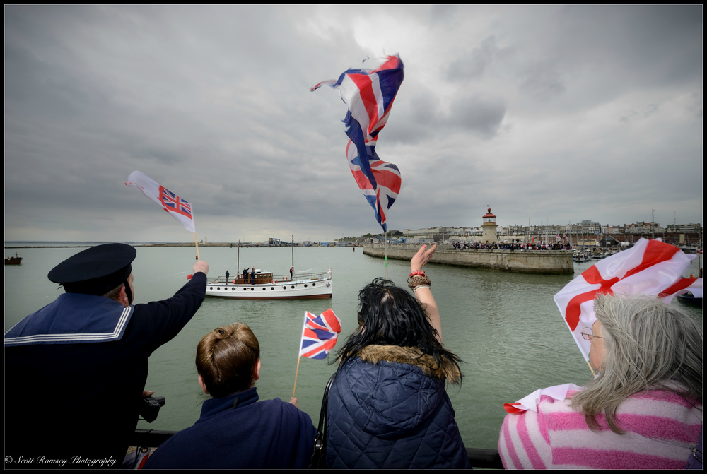 Spectators wave flags and cheer as the Dunkirk Little Ships return to the Royal Harbour Marina Ramsgate during a weekend of events to commemorate the 75th anniversary of Operation Dynamo. ©Scott Ramsey Photography