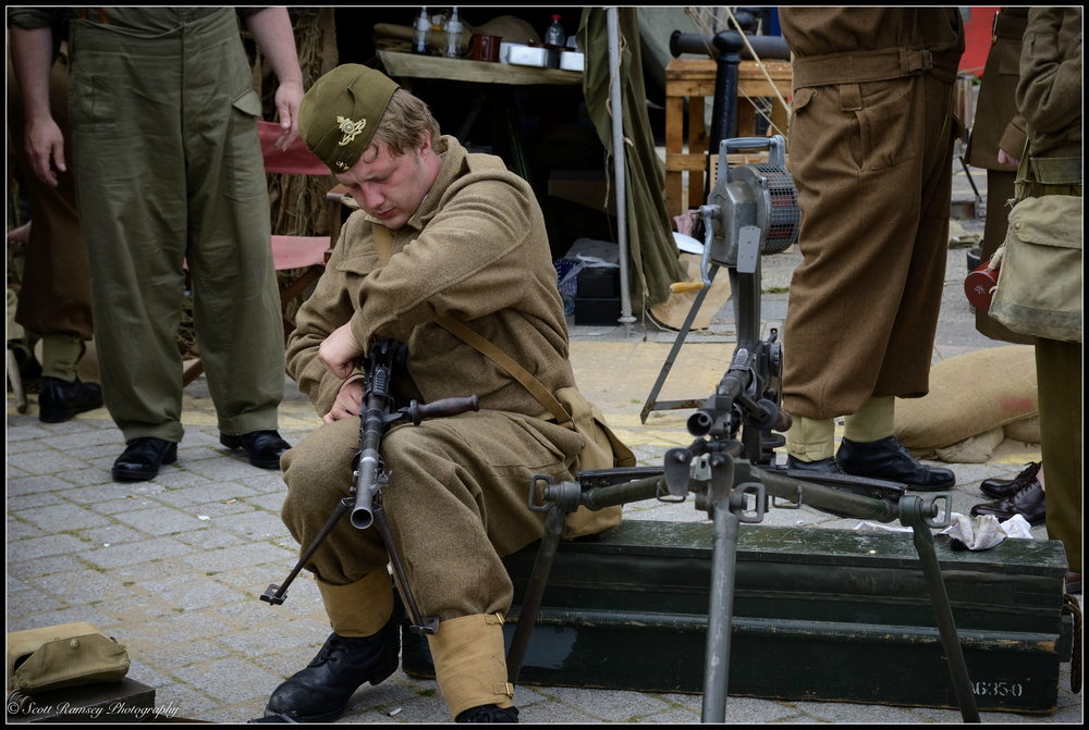 A historical military re-enactor dressed in a WW2 British uniform cleans his gun during the weekend of events to commemorate the 75th anniversary of Operation Dynamo in Ramsgate, Kent, UK. ©Scott Ramsey Photography