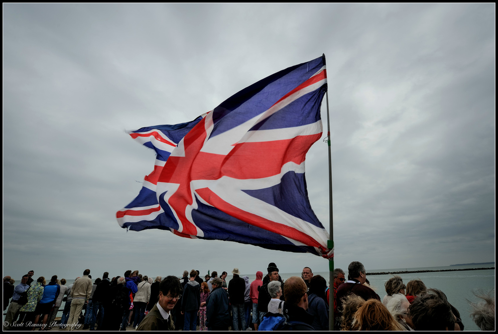 A spectator waves a Union Jack Flag in the sky whilst waiting for the Dunkirk Little Ships to return to the Royal Harbour Marina Ramsgate during a weekend of events to commemorate the 75th anniversary of Operation Dynamo. ©Scott Ramsey Photography