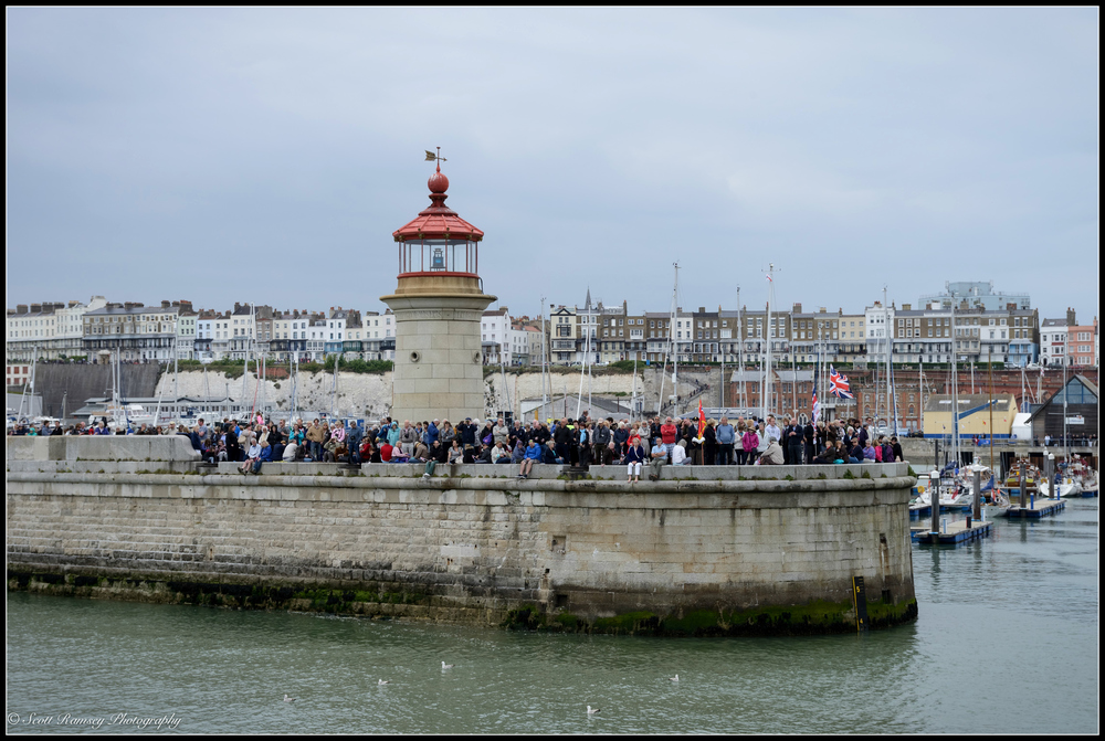 Spectators wait on the West Pier at the Royal Harbour Marina in Ramsgate, Kent, UK for the Dunkirk Little Ships to return  during a weekend of events to commemorate the 75th anniversary of Operation Dynamo. ©Scott Ramsey Photography