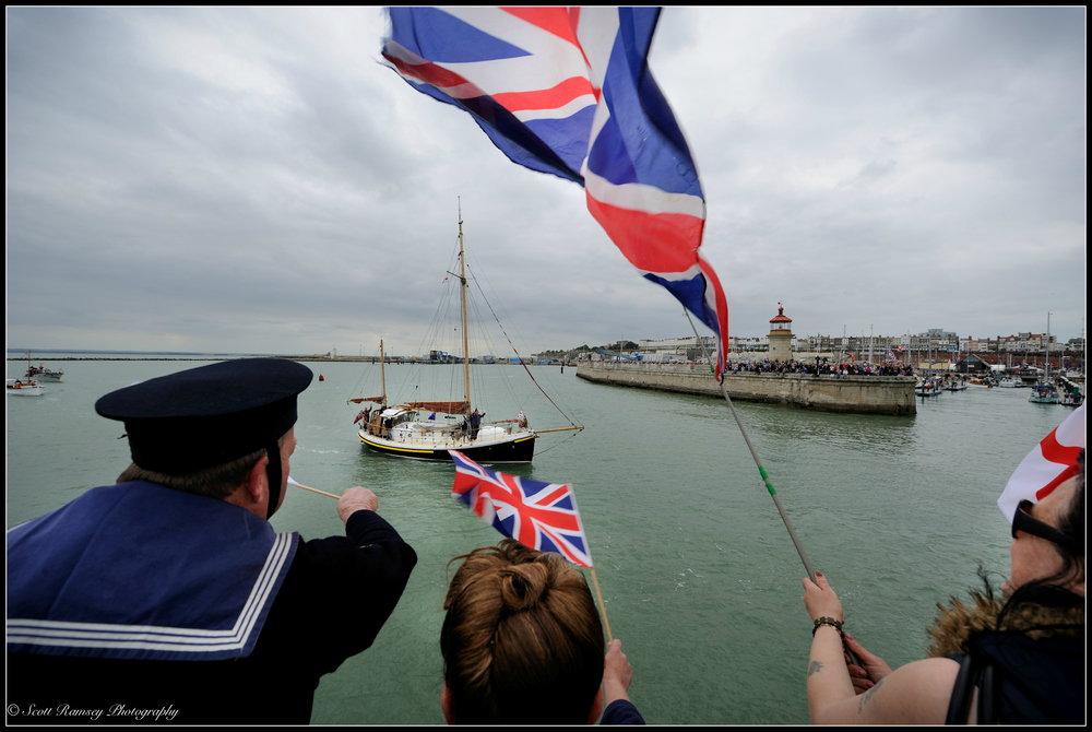 Spectators wave flags and cheer as the Dunkirk Little Ships return to the Royal Harbour Marina Ramsgate, Kent, UK during a weekend of events to commemorate the 75th anniversary of Operation Dynamo.