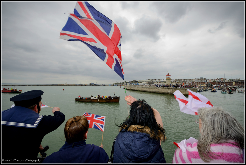 Flags are waved as the New Britannic, a 1930 passenger boat and one of the original Dunkirk Little Ships, returns to the Royal Harbour Marina Ramsgate during a weekend of events to commemorate the 75th anniversary of Operation Dynamo. ©Scott Ramsey Photography
