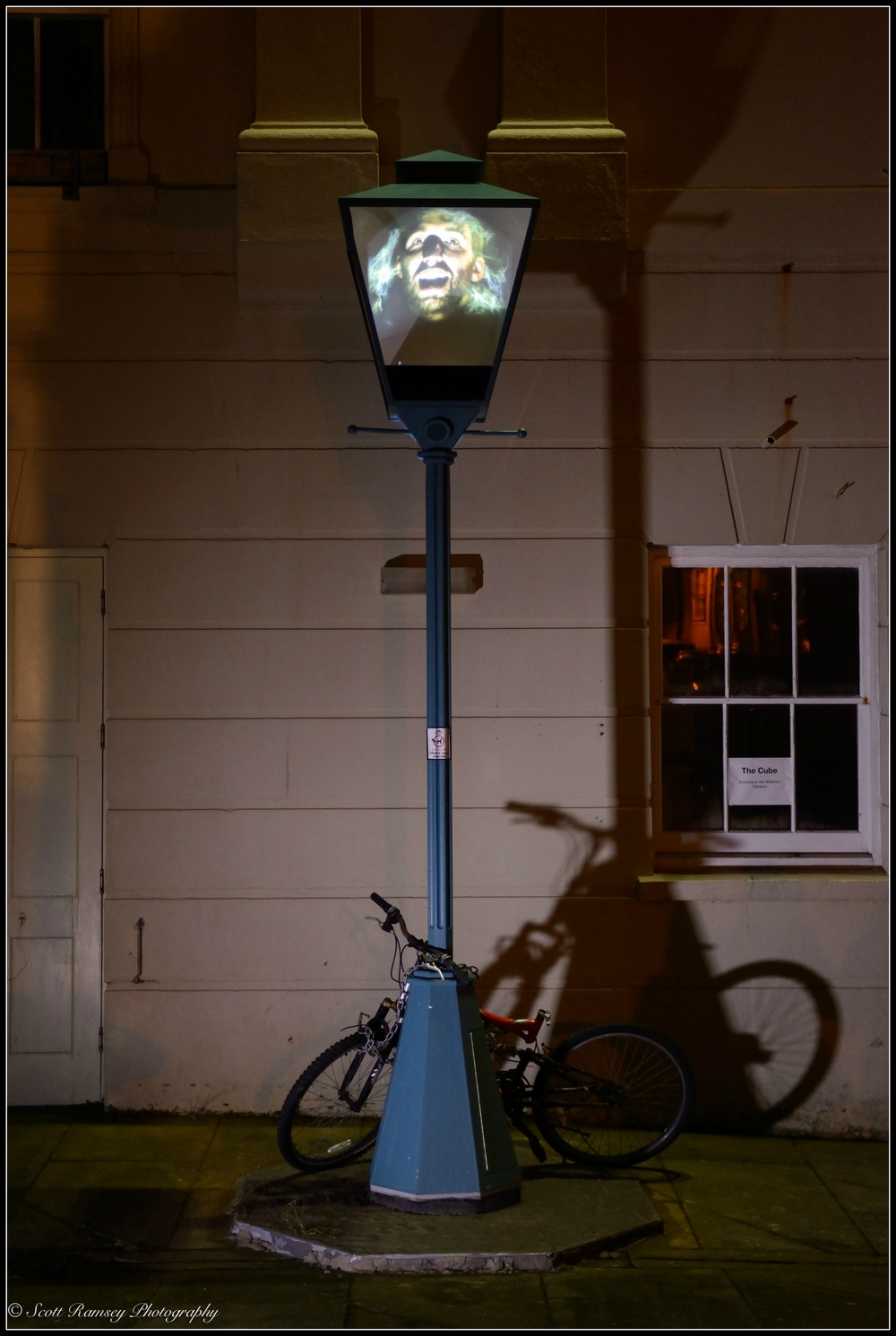 A spooky face of a man appears in the lamp post and tells a paranormal tale from the local area.