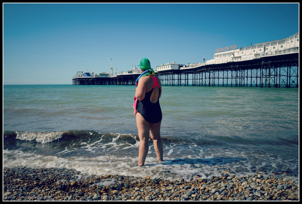 Fiona stands on the beach in front of Brighton Pier after completing her first charity swim around the pier. Photo: ©Scott Ramsey Photography