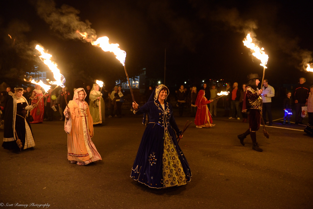 Spectators watch the bonfire procession