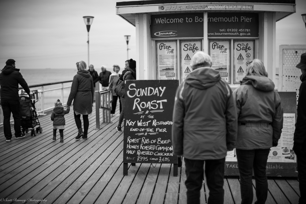 People enjoy a stroll along Bournemouth Pier, England. Photo © Scott Ramsey