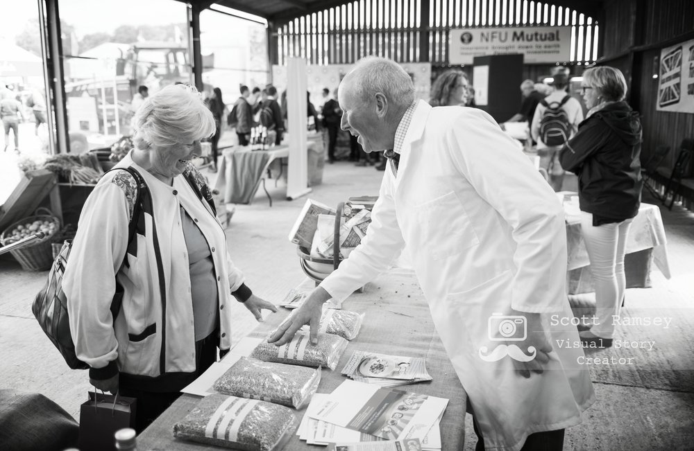 Sharing knowledge, a visitor chats to a NFU farming expert at the 2017 South Of England Show. Photo © Scott Ramsey