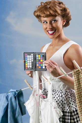 model holding an X-rite ColorChecker Passport