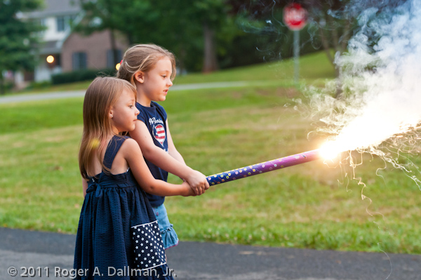 girls playing with a giant sparkler  fireworks