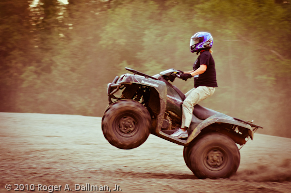 wheelie on a quad runner