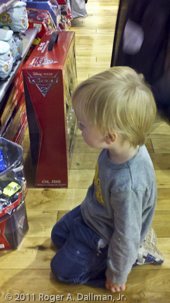 boy looking at toys