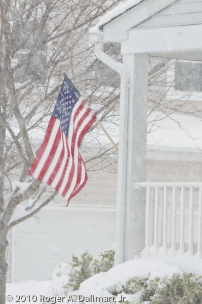 Flag in the blowing snow.