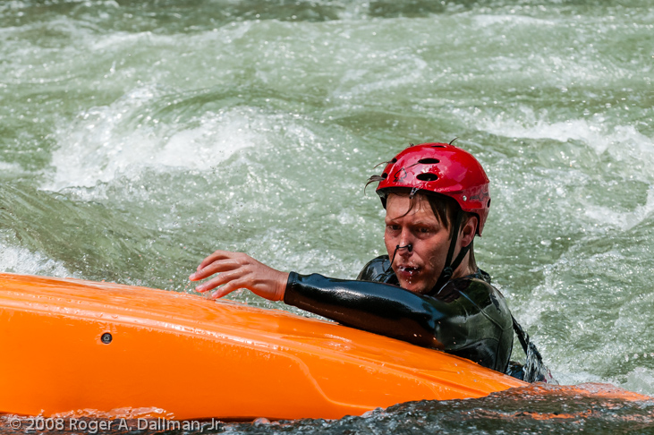 Kayaker out of his boat and in the rapids, in the Nantahala River, North Carolina