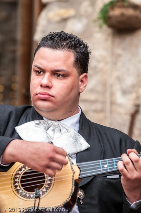 photo of a musician along the riverwalk in San Antonio, Texas