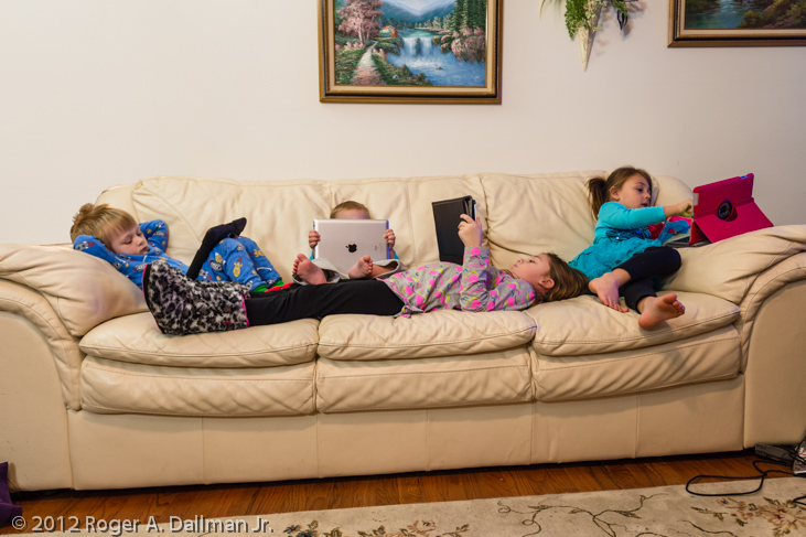 photo of kids on the couch with iPads after Christmas