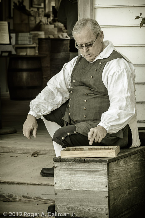 The storekeeper takes a break in Colonial Williamsburg.