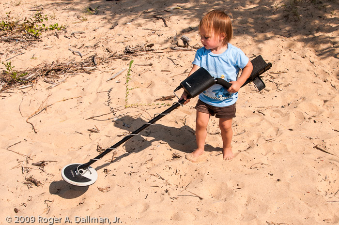 She has no idea what she's doing, but she's watched her dad wander the beach with this thing.