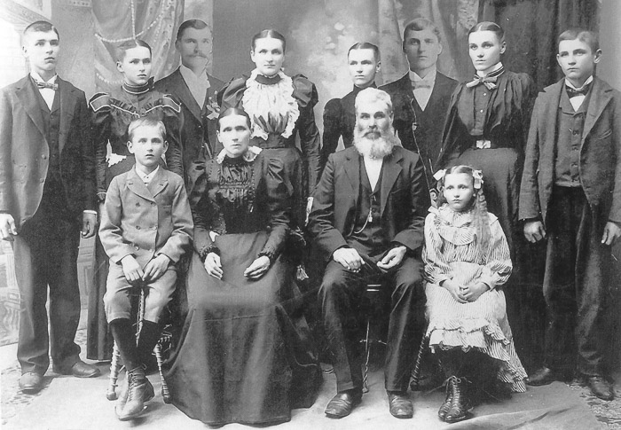 1890s family portrait. Don't let them disappear.