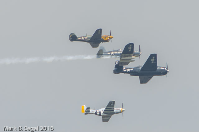 "Start of the ""Missing Man"" finale formation.  P-40, Corsair, Avenger, and a Mustang"