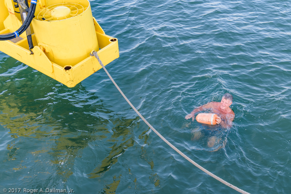 Recovering the marker buoy before lowering the fans